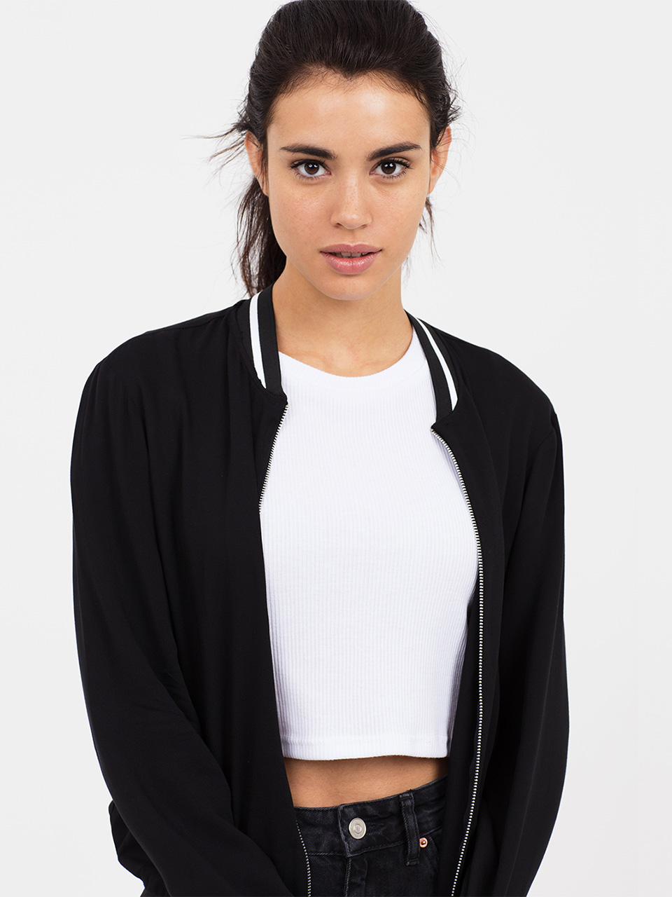 Black Sports Rib Bomber Jacket Chanel that laidback nineties look this season with our Sports Rib Bomber Jacket. We've kept the style lightweight and loose, making it perfect for springtime dressing, and kept to a monochrome colour scheme for maximum impact. Complete with ribbed trims, invisible side pockets and contrasting silver zip detailing, throw it over a crop top and jeans by day, and a bodycon dress by night. Main Fabric: 100% Viscose Contrast: 75%Polyester 25 % Elastane Item No. 69883