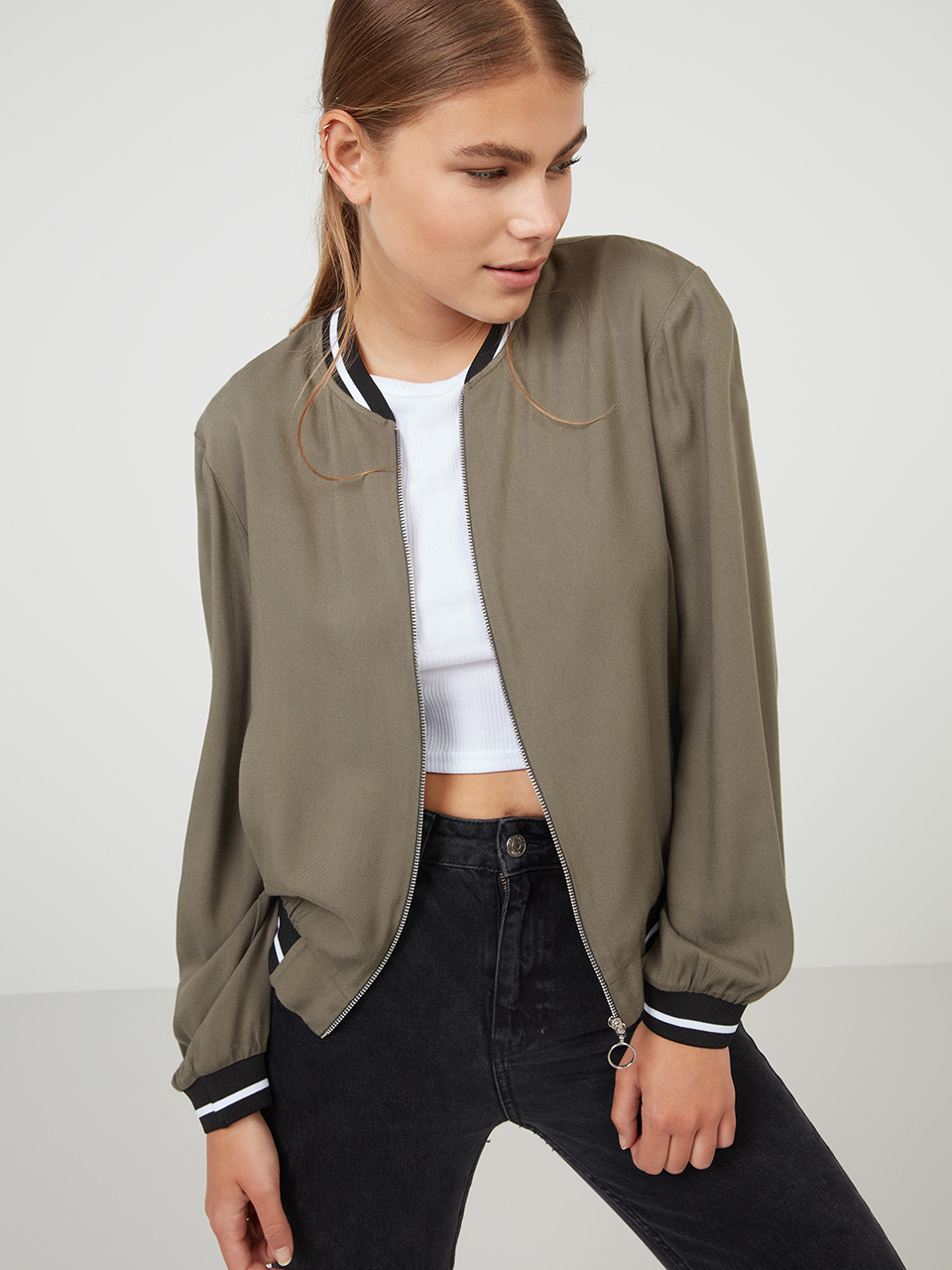 Khaki Sports Rib Bomber Jacket Style out the summer in our Khaki Bomber Jacket, designed for the warmer months ahead with its loosely tailored shape and lightweight construction. Finished in a military green, this shade's not only a catwalk favourite this season, but stays true to the jacket's roots. Throw it over a crop top with slip-on sneakers for an off-beat style statement. Main Fabric: 100% viscose - Trim 75% poly 25% elastane Lining: 100% polyester Item No. 72349