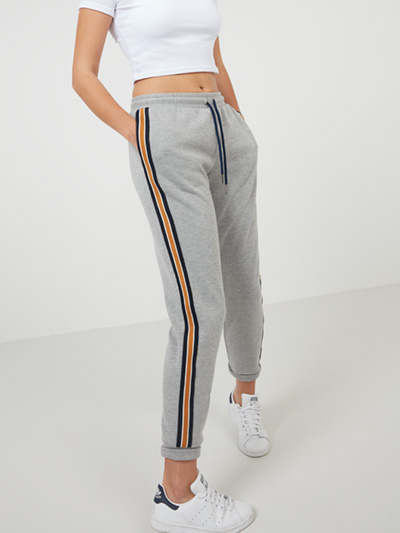 Light Grey Sports Trim Joggers Slip into our Sports Stripe Joggers for a casual take on this season's athleisure trend. Elasticated at the waist and crafted from a super soft material, metallic panelling down the sides provides that all important outfit-defining detail. Pair with trainers, a crop top and its matching grey marl hoodie for off-duty styling. Main Fabric: 50% cotton 50% polyester Contrast: 100% polyester Item No. 72895